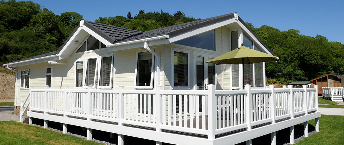 Exterior of the Arundel Twin lodge set on a beautiful holiday park.